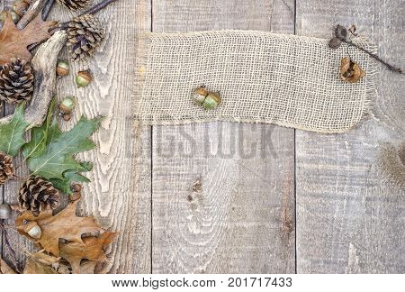 Burlap Banner, Blank Sign, On Rustic Wooden Background With Acorns, Pinecones, Leaves And Branches O