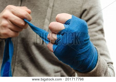 An athlete's fist a boxer bandaged with an elastic bandage