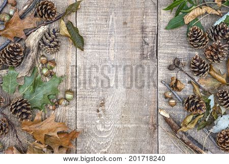 Autumn Leaves, Acorns, Pinecones And Branches On Left And Right Border Ofs Rustic Wooden Planks