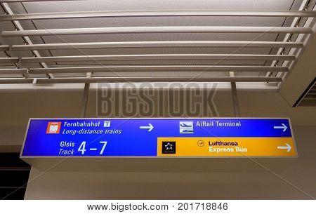 FRANKFURT GERMANY - AUG 8 2017: Airport direction sign toward Long-Distance trains AiRail terminal and Lufthansa Express Bus - communication signage in Frankfurt International Airport