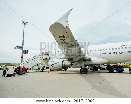 FRANKFURT GERMANY - AUG 8 2017: German police Polizei and Zoll Customs workers inspecting the passengers passports of Air Moldova Airbus aircraft on the airstair before descending - searching for illegal migrations and terrorists