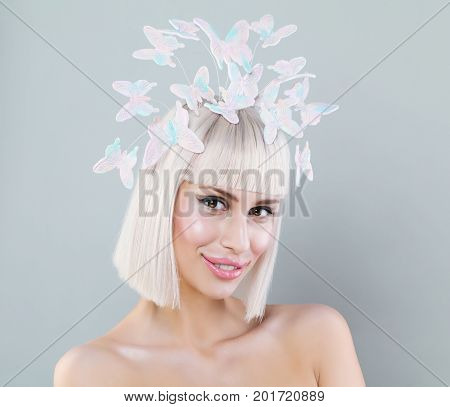 Nice Model Woman with Blonde Bob Hairstyle and Butterfly in Hair