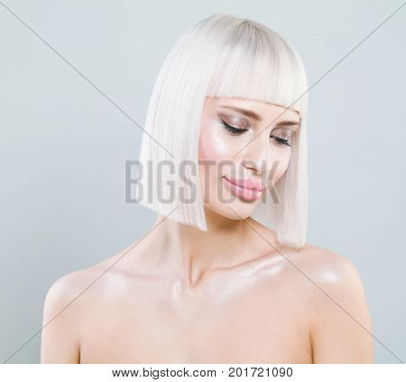 Beautiful Woman Fashion Model with Healthy Skin and Blonde Bob Hairstyle Blond Colored Hair