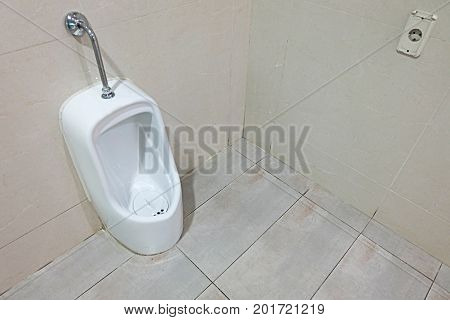 White Bowl urinals for men in toilet.