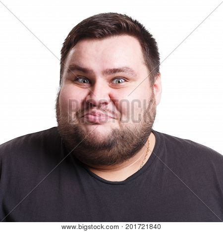 Pleasant news. Excited man expressing shock on face, smiling on white isolated studio background, portrait