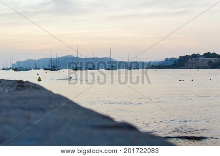 Beautiful sunset with the bay full of boats in the small town of Santa Ponca on the lively island of Mallorca. August 25, 2017. Santa Ponca, Mallorca, Spain