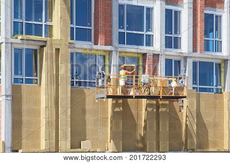Energy efficiency wall renovation for energy saving. Exterior house wall heat insulation with mineral wool building under construction