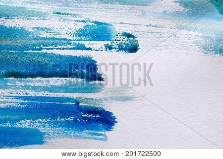 Marine blue watercolor background. Gradient brush strokes on textured white paper, top view, copy space