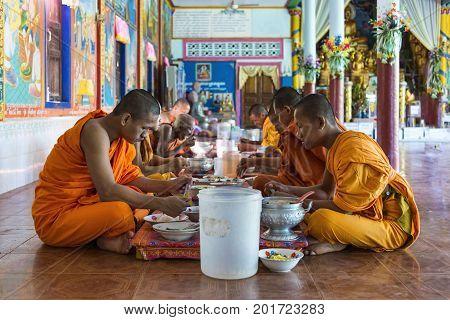 Bakong, Cambodia - January 04, 2017: Buddhist monks take lunch at the Bakong monastery, outside Bakong temple near Angkor Wat