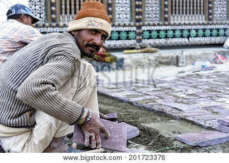 Leh, India - August 21, 2015: View of an unidentified man working in Leh main street. Leh was the capital of the Kingdom of Ladakh, now the Leh district in the Indian state of Jammu and Kashmir