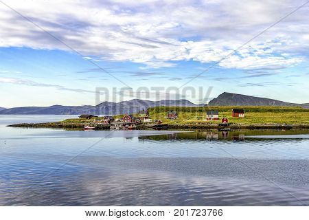 View of small fishing village in Mageroya island, Norway. Mageroya is a large island in Finnmark county, in the extreme northern part of Norway.