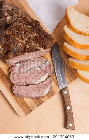 Baked Pork With Herbs And Spice On Wooden Board And And Slices White Wheat Bread.