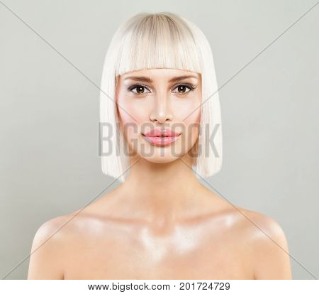 Beautiful Model Woman with Healthy Skin and Blonde Bob Hairstyle on Grey Background