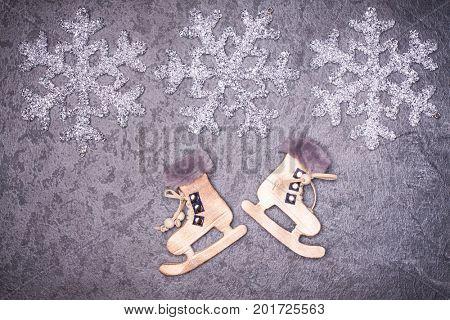 Christmas greeting card. Noel festive background. New year symbol. Skates.