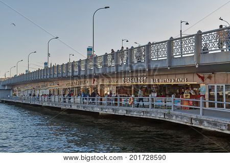 Istanbul Turkey - April 25 2017: Galata Bridge with traditional fish restaurants in the passage under the bridge