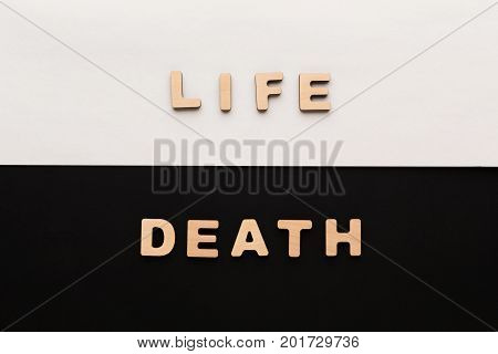 Word Life and Death on contrast background. Life cycle, lifetime concept