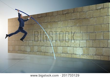 Businessman jumping over brickwall in business concept