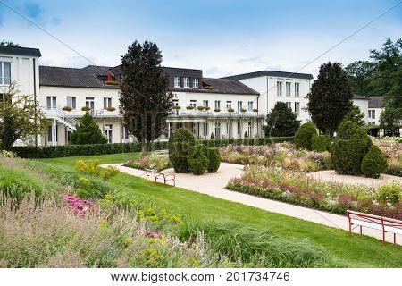 Building in a park with flowers and shrubs