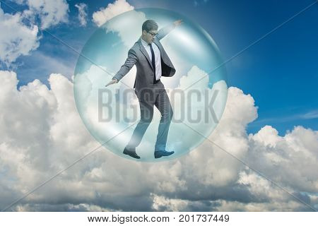 Businessman flying inside the bubble
