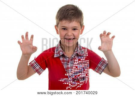 Portrait of emotionally kid, roaring like a lion on white background.