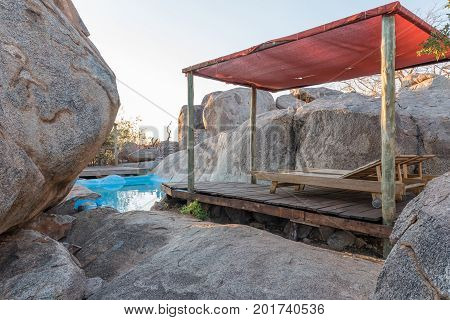 HOADA NAMIBIA - JUNE 27 2017: A swimming pool hidden between boulder on a hill at the Hoada Camp in the Kunene Region of Namibia