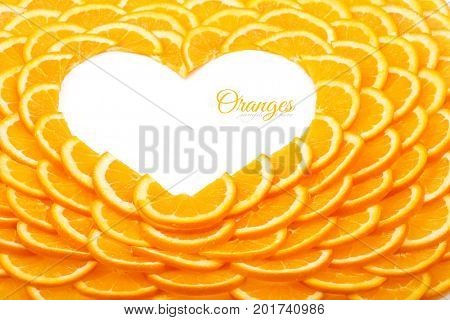 Background of orange slices. The shape of the heart from orange slices.
