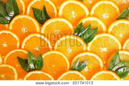 Background of orange slices with a leaf