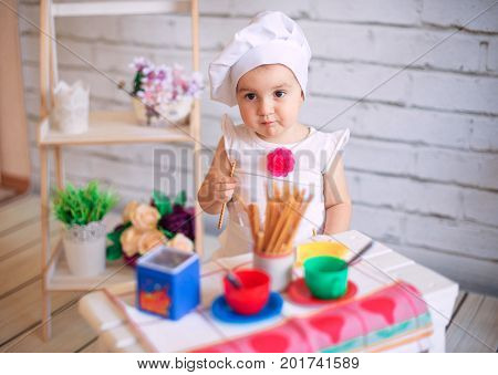 Child Chef Cook, Little Girl In Cook Hat Look At Camera . Restaurant Business Concept