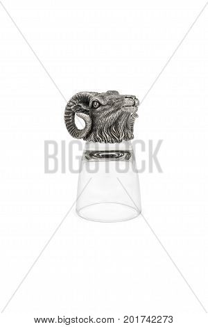Inverted glass for vodka with ram's head on the bottom isolated on white background