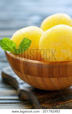 Melon Sorbet In A Wooden Bowl.