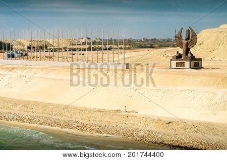 Sinai Egypt - April 2nd 2016: Section of the Suez Canal's expansion canal opened in August 2015 with the al-Sisi monument