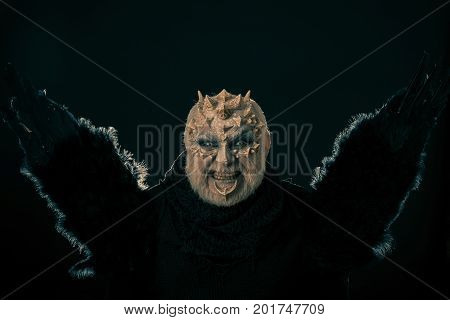 Man With Beard And Thorns On Grimace Face
