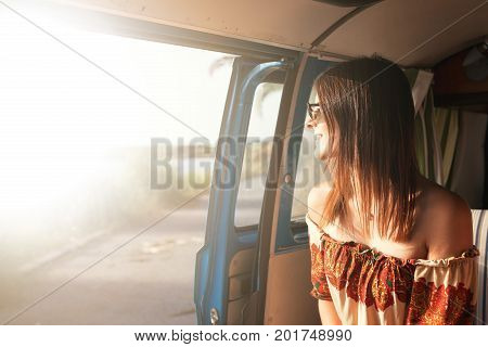 summer holidays road trip travel and people concept young woman resting in minivan car