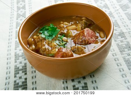 Fasole cu carnati - beans with sausages. popular Romanian dish consisting of baked beans and sausages.