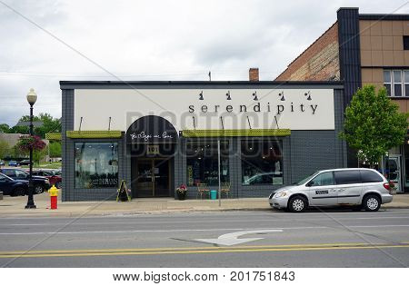CADILLAC, MICHIGAN / UNITED STATES - MAY 31, 2017: One may purchase women's clothing and accessories at Serendipity, on Mitchell Street in Downtown Cadillac.
