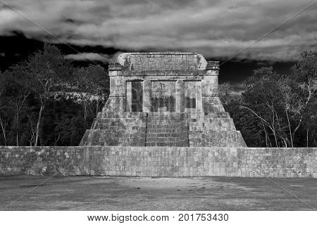 A beautiful photograph of the Temple of Bearded Man in the ball game of the ancient Mayan city of Chichen Itza black and white afternoon light