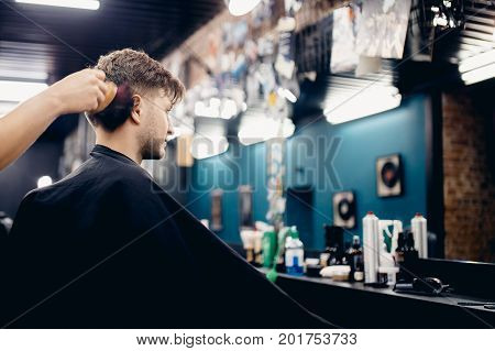 Man is doing a haircut. Men's hairdresser's barber shop