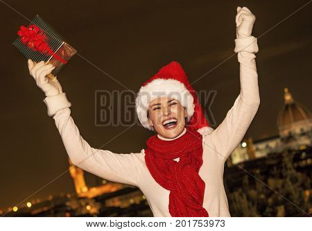 Woman At Piazzale Michelangelo With Christmas Gift Rejoicing