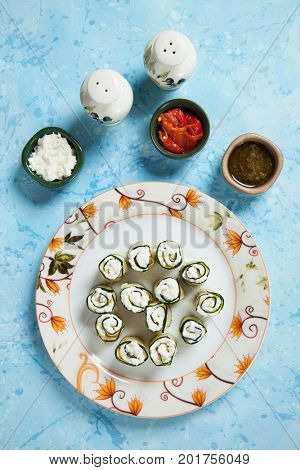 Zucchini rolls filled with fresh cottage cheese