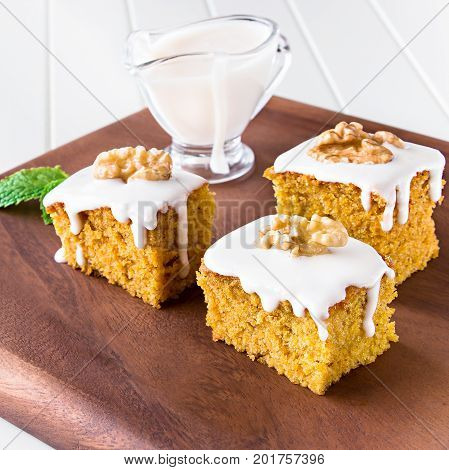 Pieces Of Homemade Carrot Cake With Nuts And Icing Cream On Wooden Tray. Selective Focus. Close Up.