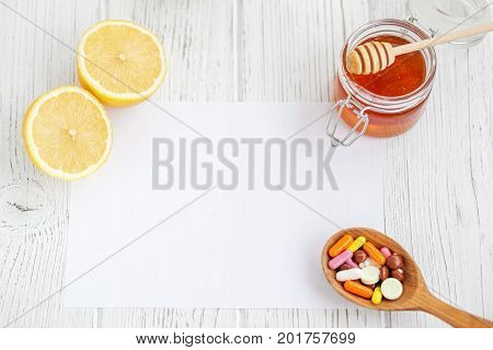 Honey and lemon. Tablets. A recipe sheet. Concept illness colds cure fall and winter.