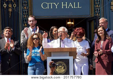 San Francisco CA - August 25 2017: Mayor Edwin M. Lee speaks to the crowd at the Unite Against Hate rally at Civic Center in front of City Hall in San Francisco.