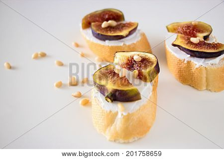 Sandwich Bruschetta With Fig And Goat Cheese On White Background. Shallow Depth Of Field. Selective