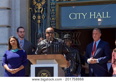 San Francisco CA - August 25 2017: Musician M.C. Hammer speaks out against hate to the crowd at the Unite Against Hate rally at Civic Center in front of City Hall in San Francisco.