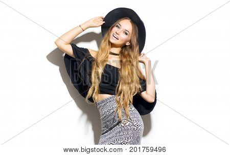 Beauty Fashion model girl wearing stylish hat. Sexy woman portrait with perfect makeup, trendy accessories and fashion wear. Beauty trends. Isolated on white. Fashion blogger