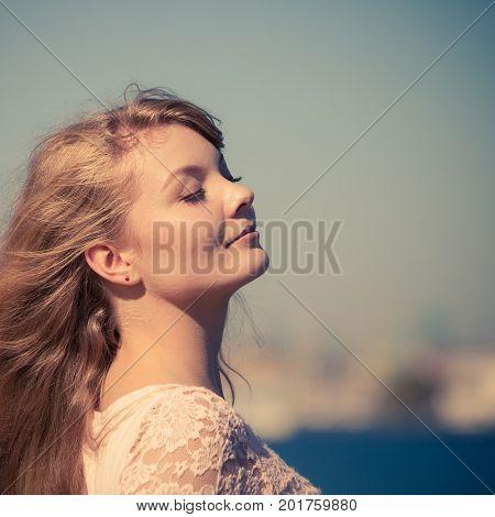 Lovely Blonde Girl Relaxing Outdoor By Seaside