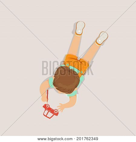 Little boy lying on his stomach and drawing a car using red pencil, top view of child on the floor vector Illustration