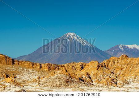 View on Volcano Licancabur at the border of Chile to Bolivia by San Pedro de Atacama