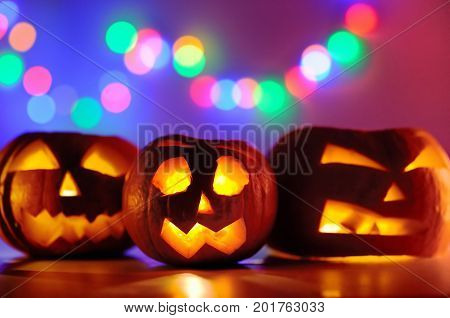 Halloween Pumpkins Head Jack-o-lanterns With Lights On Background