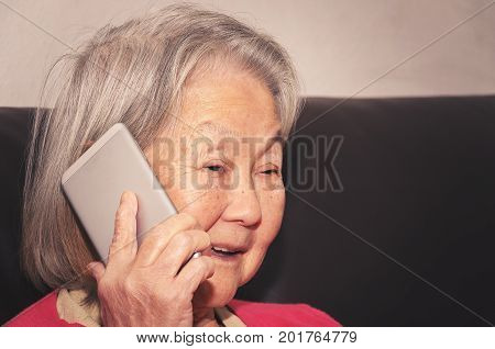 Old Woman Talking Happy On The Phone.